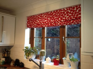 Eyelet Curtains and Roman Blinds.